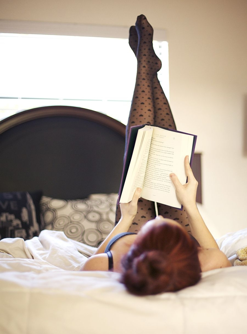 girl on bed reading book